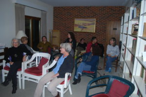 Residents gather for a reading in the VCCA library